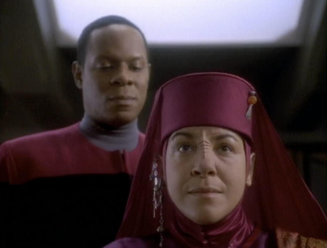Sisko looking suspiciously at Kai Opaka in DS9 episode Emissary.